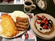 Hashbrowns, over easy eggs, toast, yogurt & granola from Metro Diner